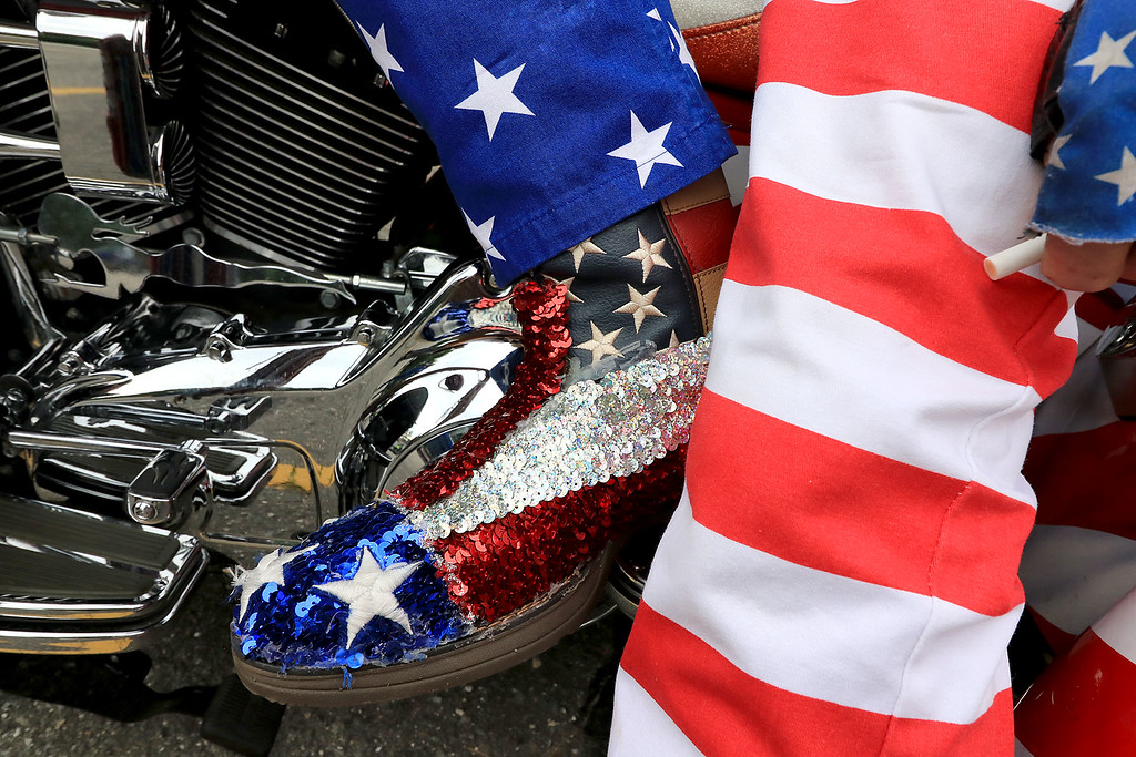 """. The Middlesex GWOT (Global War on Terror) held a funraiser motorcycle \""""Freedom Ride\"""" to raise money for their Global War on Terror Veterans Monument that will be put up near the rotary in Pepperell. They need $200,000 for the monument. They only need $50,000 more to start work on it. At the ride they hoped  to raise $5,000 for the day. The ride was just over 80 miles and ended where it started at the Pepperell VFW. A close up of veteran Army SGT. Lance Blais, of Groveland MA., very patriotic boots and pants he had on for the ride. SENTINEL & ENTERPRISE/JOHN LOVE"""