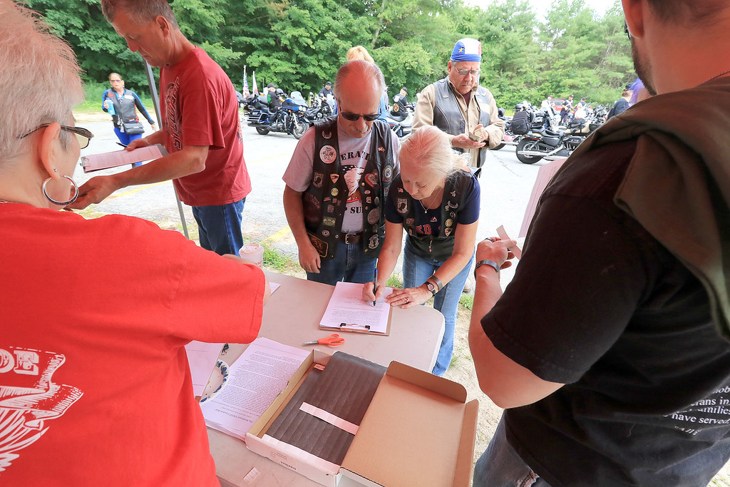 """. The Middlesex GWOT (Global War on Terror) held a funraiser motorcycle \""""Freedom Ride\"""" to raise money for their Global War on Terror Veterans Monument that will be put up near the rotary in Pepperell. They need $200,000 for the monument. They only need $50,000 more to start work on it. At the ride they hoped  to raise $5,000 for the day. The ride was just over 80 miles and ended where it started at the Pepperell VFW. Riders sign in to do the ride on Saturday morning. SENTINEL & ENTERPRISE/JOHN LOVE"""