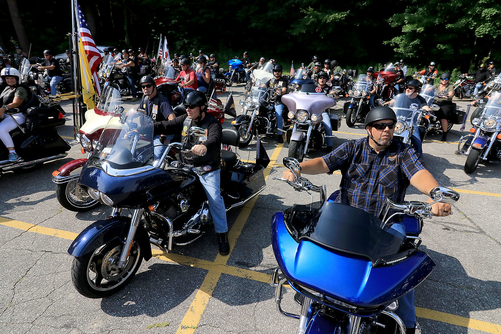 """. The Middlesex GWOT (Global War on Terror) held a funraiser motorcycle \""""Freedom Ride\"""" to raise money for their Global War on Terror Veterans Monument that will be put up near the rotary in Pepperell. They need $200,000 for the monument. They only need $50,000 more to start work on it. At the ride they hoped  to raise $5,000 for the day. The ride was just over 80 miles and ended where it started at the Pepperell VFW. Riders get ready for the ride to start on Saturday. SENTINEL & ENTERPRISE/JOHN LOVE"""
