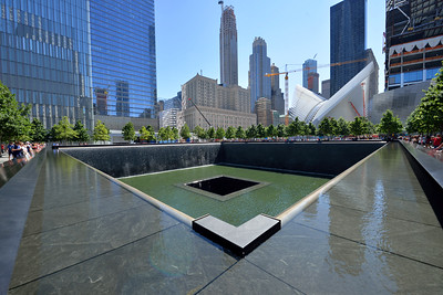 Looking diagonally across the Reflection Pool Memorial, created in the foot print of the  of the old WTC north  tower.  The Freedom Tower is the building to the left in this photo..