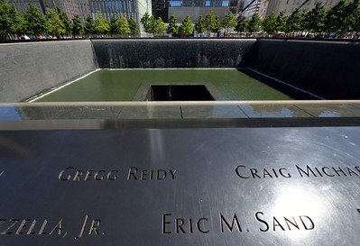 The names of victim's from 9-11 engraved in the Reflection Pool Memorial.