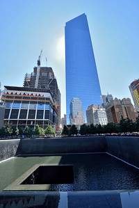 Looking across the south reflection pool .  Surrounding buildings reflected off the WTC building.