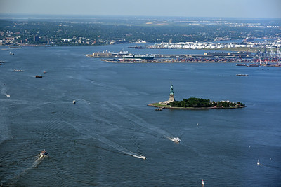 Liberty Island and the Statue of Liberty.  New Jersey in the distance