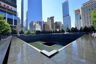 The Reflection Pool Memorial  created in the foot print of the old WTC  South Tower..  Ladder Co. 10 Engine Co. 10 is just beyond the trees, on the opposite side of the memorial.