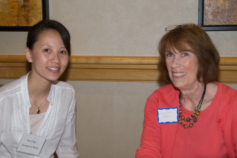 50+ Employment Expo -- In the Resume Room, Mary Ngo (a manager at Montgomery Works) assists Eileen Glew with her resume.