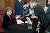 Arlene Alda signing books.
