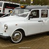 Heritage Wedding Cars' white London Taxi