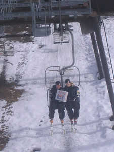 Emily Cook (left) and Lacy Schnoor with the chair lift pizza delivery for team coaches Thursday in Madonna di Campiglio (credit: Doug Haney/U.S. Ski Teaam)