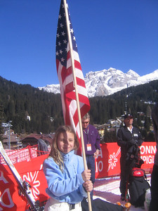 A young fan from Switzerland poses with the American flag to cheer on her favorite athlete, Ryan St. Onge (credit: Doug Haney/U.S. Ski Team)