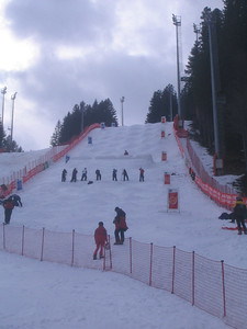 Volunteers soften up the landing area for the moguls kickers prior to Thursday evenings training session in Madonna di Campiglio (credit: Doug Haney/U.S. Ski Team)