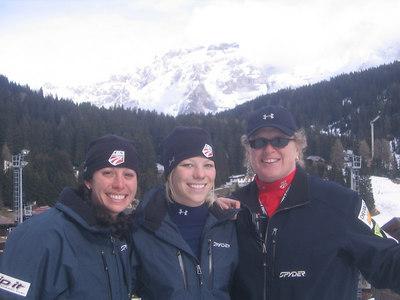 (l-r) Emily Cook, Lacy Schnoor and U.S. Freestyle Ski Team Program Director Polly-Jo Clark watch men's aerials training Thursday in Madonna di Campiglio (credit: Doug Haney/U.S. Ski Team)