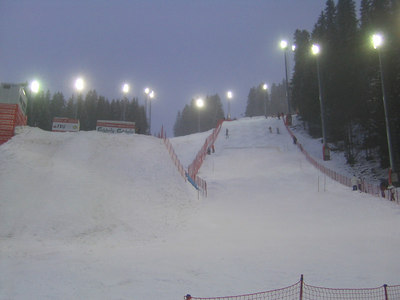 A look at the aerials hill (left) and the moguls course during moguls training at night, Wednesday, March 7, 2007 (credit: Doug Haney/U.S. Ski Team)