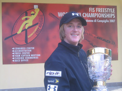 Scotty Bahrke poses with the FIS Rookie of the Year trophy for aerials after being awarded the cup during the coaches meeting Thursday in Madonna di Campiglio (credit: Doug Haney/U.S. Ski Team)