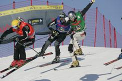 Ski Cross event at Ruka in Finland.  Tyler Shepherd, U.S. Ski Cross Head Coach (yellow helmet). Credit Brian W. Robb