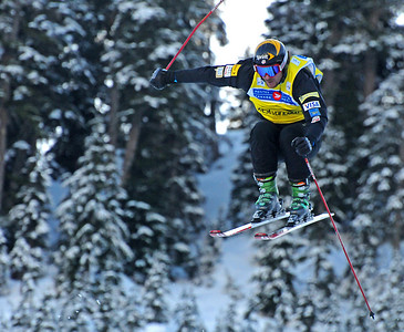 Casey Puckett soars off a jump in the Ski Cross World Cup at Cypress Mountain Olympic test event. (U.S. Ski Team-Tom Kelly)