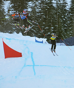 Daron Rahlves (red bib in middle) gets taken out on the fnial jump in the Ski Cross World Cup at Cypress Mountain Olympic test event. (U.S. Ski Team-Tom Kelly)