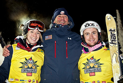 The U.S. Ski Team celebrates a victory sweep in the FIS World Cup moguls opener in Ruka, Finland. Olympic champion Hannah Kearney (left) won the women's moguls while 2009 World Champion Patrick Deneen (right) won the men's. Pictured in middle is Moguls Head Coach Scott Rawles. Photo: Harald Marbler/U.S. Ski Team