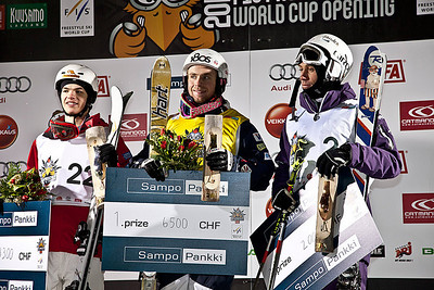 2009 World Champion Patrick Deneen stands atop the podium in Ruka, Finland for his first World Cup win. Photo: Harald Marbler/U.S. Ski Team