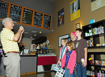 Kids pose for a photo with Olympic medalist Shannon Bahrke as she opens her new flagship coffee ship as a part of her Silver Bean Coffee in Salt Lake City, Utah. (c) 2010 USSA