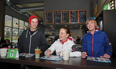 Teammates sign autographs including (from left) U.S. Ski Team aerialist Dylan Ferguson, World Ski Jumping Champion Lindsey Van, and aerialist Scotty Bahrke, as Olympic medalist Shannon Bahrke opens her new flagship coffee ship as a part of her Silver Bean Coffee in Salt Lake City, Utah. (c) 2010 USSA