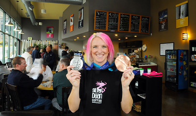Olympic medalist Shannon Bahrke proudly displays her silver and bronze medals as she opens here new flagship coffee ship as a part of her Silver Bean Coffee in Salt Lake City, Utah. (c) 2010 USSA