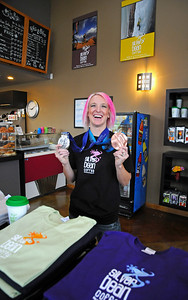 Olympic medalist Shannon Bahrke poses with her silver and bronze medals as she opens her new flagship coffee ship as a part of her Silver Bean Coffee in Salt Lake City, Utah. (c) 2010 USSA