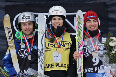 Mens Moguls podium (l-r) Patrick Deneen (USA) 2nd place, Mikael Kingsbury (CAN) 1st place, Philippe Marquis (CAN) 3rd place. 2012 USANA Lake Placid Freestyle Cup Photo: Harald Marbler and Garth Hager