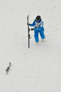 Oops! Allison Lee recovers her gear after crashing on landing at the U.S. Ski Team Selections NorAm aerials at Utah Olympic Park in Park City, Utah. (USSA/Tom Kelly)