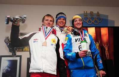 Men's NorAm Cup podium including 3rd place Petr Medulich, winner Timefei Slivets, and 2nd place Scotty Bahrke.