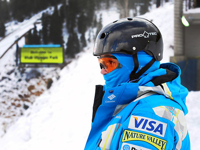 """It was a """"thank goodness for Columbia"""" day in the wind and cold as an athlete peers out over the landing hill at the U.S. Ski Team Selections NorAm aerials at Utah Olympic Park in Park City, Utah. (USSA/Tom Kelly)"""