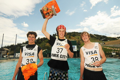 Dylan Ferguson (center) tops the podium along with Scotty Bahrke second (right) and Hans Gardner (left) third at the Festival of Flight Aerials in the Utah Olympic Park Splash Pool. (c) 2011 USSA/Tom Kelly