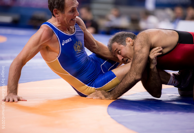 Shirzad AHMADI (USA) df  Viktor CHIRKOV (RUS) by TF, 12-2                                       Photo Robbert Wijtman-2