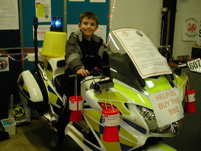 A future Freewheelers volunteer tries out the bike for size