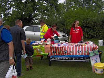 Louis & Jackie, being kept busy with the tombola and Lucky Straw.  We raised ?158.11, incl proceeds from balloon race & 'Sit on Bike' photos