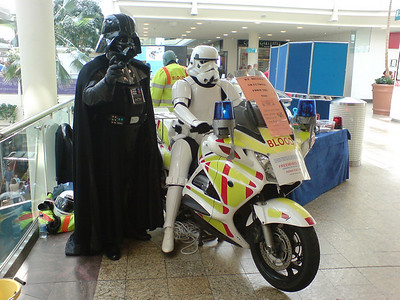 Darth Vader and Imperial Storm Trooper number 35728 forced to seek alternative transport after the Death Star gets wheel clamped in the car park