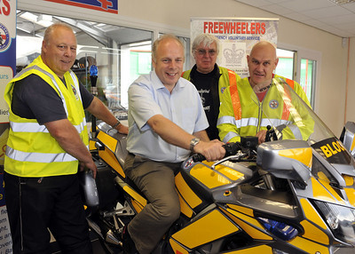 Ian Liddell-Grainger MP takes a ride with The Freewheelers at the opening of Autofit in Bridgwater.  From left are Allan Roberts, Dave Hobbs and Richard Reeves