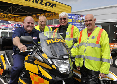 Paul Roger MD of Autofit takes a ride with the Freewheelers.From left are Allan Roberts, Dave Hobbs and Richard Reeves