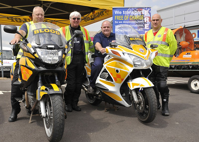 Paul Rogers MD of Autofit takes a ride with the Freewheelers. From left are Allan Roberts, Dave Hobbs and Richard Reeves