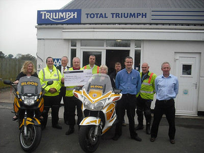 Cheque presentation to Freewheelers by Total Triumph