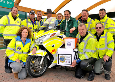 Sanders Gardenworld Duty Manager Aleck Ward, mounted centre, pictured with volunteers from Freewheelers EVS at the Vintage and Classic Vehicle weekend held at the garden centre.