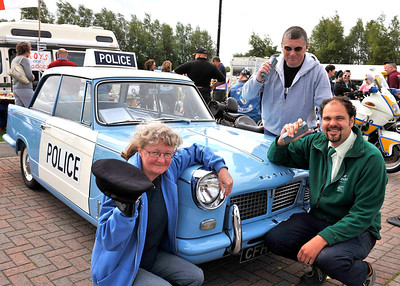 Calling all cars - Sanders Gardenworld Duty Manager Aleck Ward, right, joins June and Les Wrighton from Yate with their 1964 Triumph Herald Panda Car at the Vintage and Classic Vehicle weekend at the garden centre.