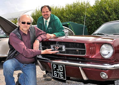 Paul Chamberlain from East Huntspill, left, shows off his original 1965 Ford Mustang Coupe to Sanders Gardenworld Duty Manager Aleck Ward at the Vintage and Classic Vehicle Weekend held at the garden centre.