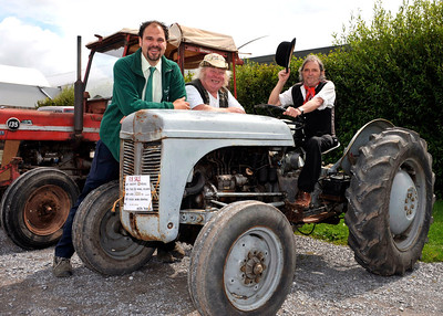 Sanders Gardenworld Duty Manager Aleck Ward, left, pictured with Joe Cook, centre, and 'Wurzel' Paul Newman from Bridgwater and his 1950's Fordson T20 Diesel tractor on display at the Vintage and Classic Vehicle weekend at Sanders Gardenworld