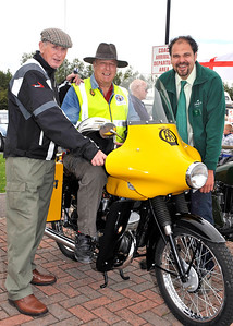 Allan Roberts from Freewheelers, centre, tries out  a 1956 BSA  175cc Bantam AA bike owned by Ivor Gore, left, watched by Sanders Gardenworld Duty Manager Aleck Ward at the Vintage and Classic Vehicle weekend at the garden centre