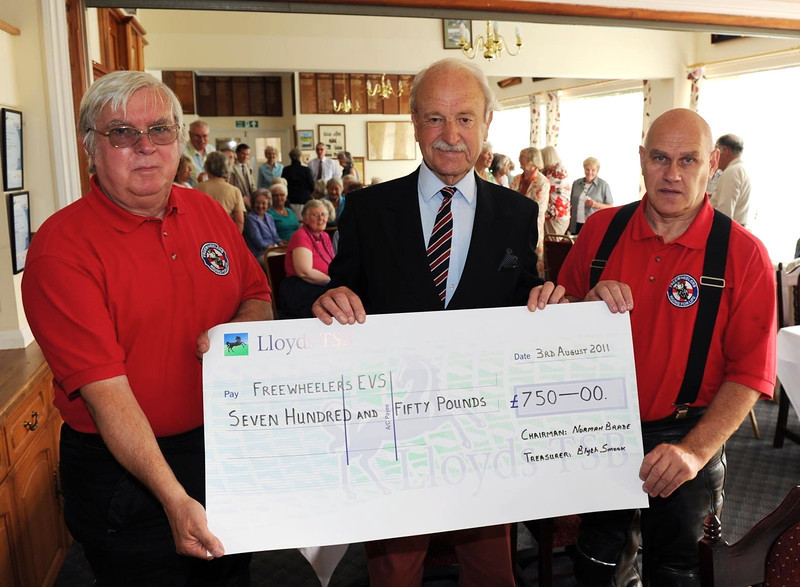 Royal Overseas League Taunton present Dave Hobbs (left) and Richard Reeves with a cheque for £750, the most that they have ever raised for a charity before.