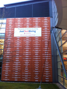 Every building at Vodafone's HQ in Newbury has a wall like this with tiles listing the names and fundraising codes for charities that use the company's JustTextGiving service.