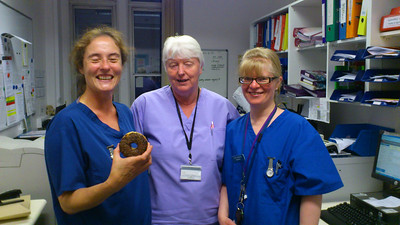 'CATHY' (holding a spare doughnut wheel).  The creative genius behind the artwork and poetry with two of her midwife colleagues.  Chippenham Birthing Unit.