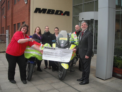 Freewheelers Treasurer Mel Rowbottom receiving the cheque from the MBDA UK ltd Charity team (l-r) Amy Crawford, Michael Holding, Sandy Stanton, Kerry Tatlock and Ray Watts. Plus  Penny Taylor who couldn't be there on the day.