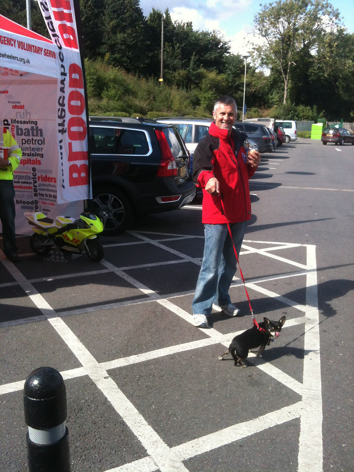 Andy was given the onerous task of looking after 'Killer' while his master had a sit on the bike!
