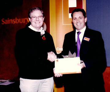 Peter Hawkes receives a ?500 donation from the chief executive of Sainsbury's - December 2005